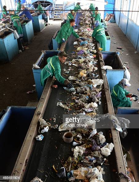 Moroccan labourers recycle waste at the Attawafoq cooperative at Oum Azza industrial landfill in Ain Aouda south of Rabat on October 5 2015 Morocco...