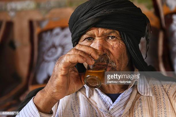 Moroccan man drinking Maghrebi mint tea.