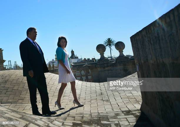 Moroccan Minister of Interior Abdelouafi Laftit chats with Portuguese Minister of Interior Constanca Urbano de Sousa as they walk on the rooftop of...