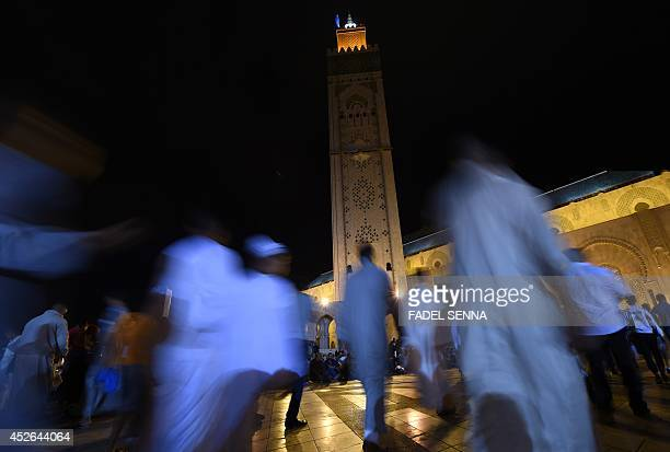 Moroccan Muslims arrive at Hassan II mosque in Casablanca late on July 24 2014 for the 'Lailat alQadr' prayer which falls on the 27th day of the holy...