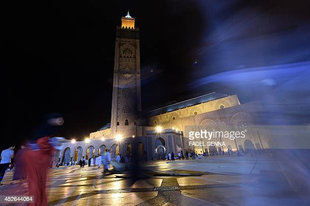 Moroccan Muslims arrive at Hassan II mosque in Casablanca late on July 24 2014 to perform the 'Lailat alQadr' prayer which falls on the 27th day of...