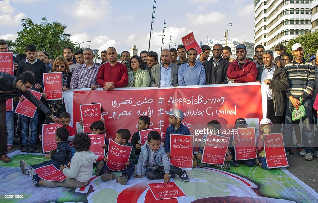 Moroccan people hold banners during a protest against Syrian regime forces and Russian air forces' attack to Aleppo, in Casablanca, Morocco on April 30, 2016.