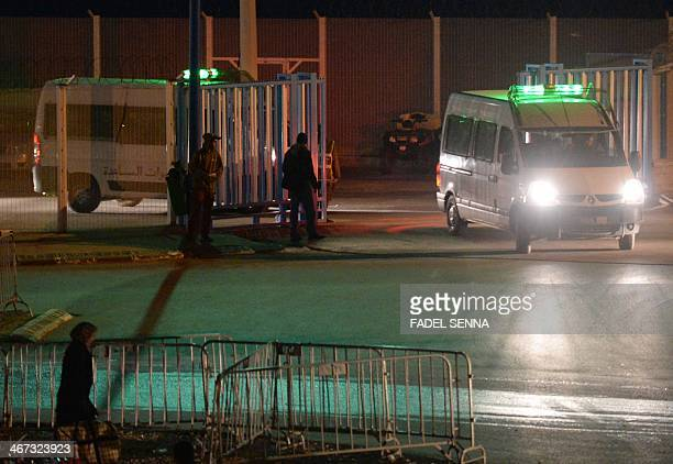 Moroccan police cars are seen on the border between the Spanish enclave of Ceuta and Morocco on February 6 2014 after eight migrants drowned while...