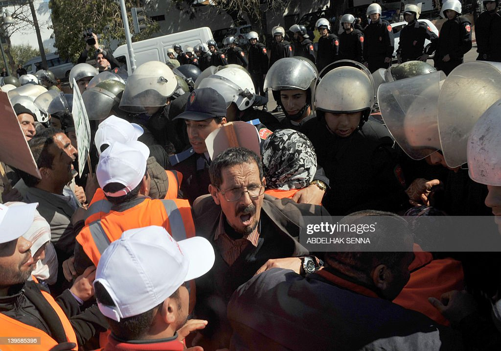 Moroccan police officers prevent Moroccan army veterans, who were held prisoners by Polisario fighters, some of them for thirty years, and their relatives to access the Royal Palace as they demonstrate to ask for ''justice and dignity'' and a pension increase to the King on February 23, 2011 in Rabat. Morocco annexed Western Sahara in 1976 after a Spanish withdrawal, and Polisario fighters took up arms for an independent state.