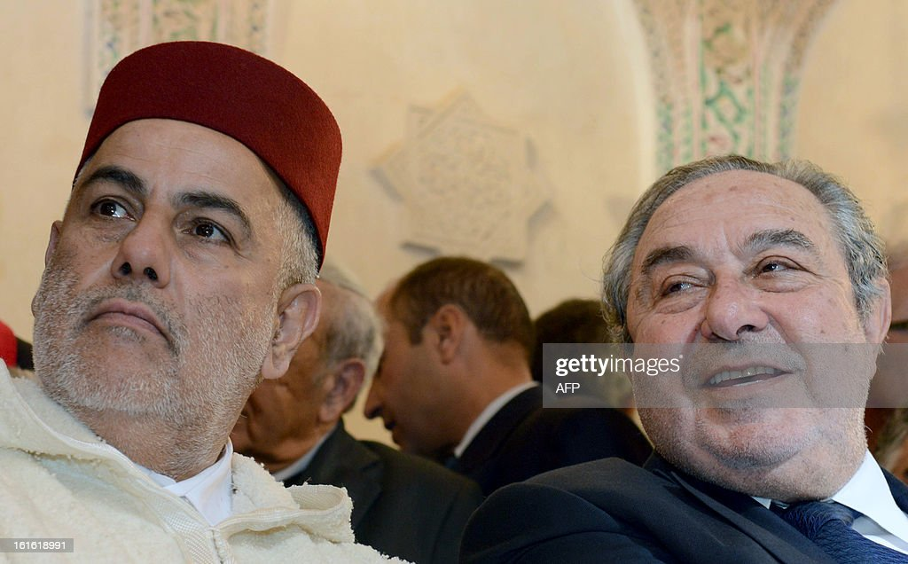 Moroccan Prime Minister Abdelilah Benkirane (L) and Serge Berdugo, the head of the Jewish community council in Morocco, attend the inauguration of the Slat Alfassiyine synagogue in the city of Fez, on February 13, 2013. The two-year restoration of the 17th century synagogue bore 'eloquent testimony to the spiritual wealth and diversity of the Kingdom of Morocco and its heritage,' Moroccan King Mohammed said in a message read by Benkirane.