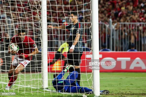 Moroccan professional footballer Walid Azaro of AlAhly scores a goal during the CAF Champions League quarterfinal firstleg football match between...