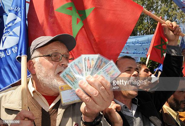 A Moroccan protester shows his professional cards during a demonstration of the Moroccan Labour Union in Nador in front of the Ministry of Foreign...