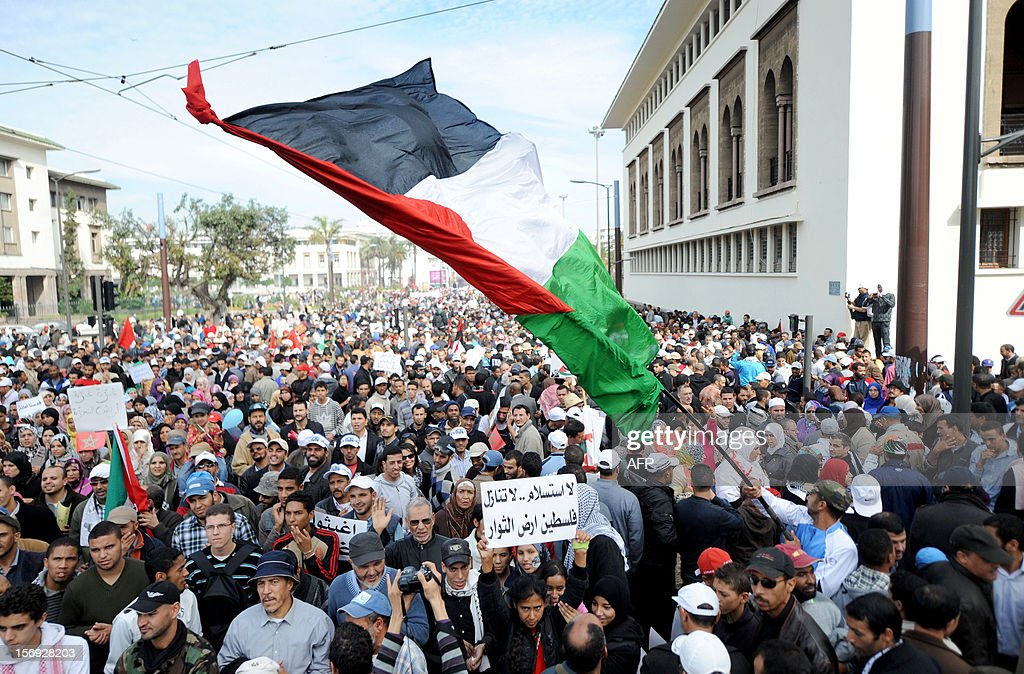 A Moroccan protestor waves a large Palestinian flag during a demonstration in Casablanca on November 25, 2012, in support of the Palestinians after Israel's devastating eight-day bombardment of the Gaza Strip. A parallel demonstration took place in the city of Rabat where over 45,000 protestors condemned Israel for 'crimes against humanity' during the assault that killed more than 160 Gazans, and criticised Washington for supporting the Jewish state.