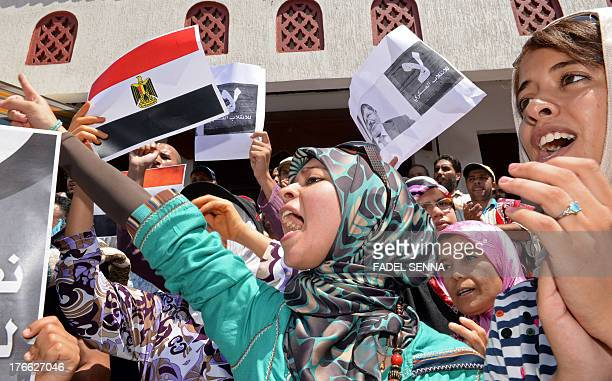 Moroccan protestors hold Egyptian flags as they chant slogans during a rally in Rabat against the violence in Egypt and in support of Egypt's ousted...
