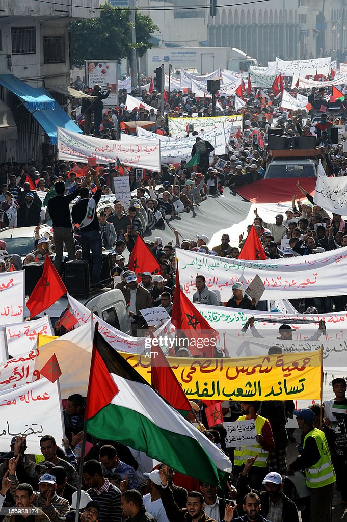 Moroccan protestors wave their national flag alongside Palestinian flags and banners during a demonstration in Casablanca on November 25, 2012, in support of the Palestinians after Israel's devastating eight-day bombardment of the Gaza Strip. A parallel demonstration took place in the city of Rabat where over 45,000 protestors condemned Israel for 'crimes against humanity' during the assault that killed more than 160 Gazans, and criticised Washington for supporting the Jewish state.
