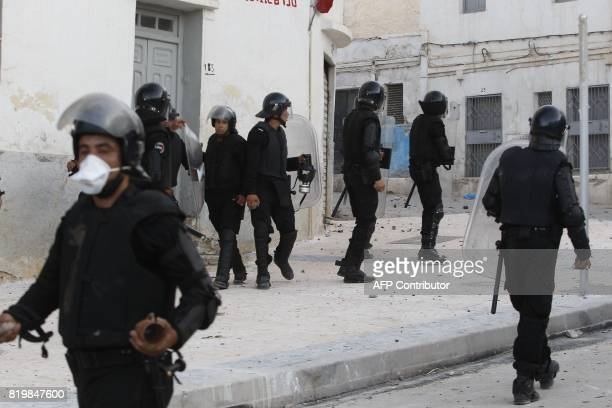 Moroccan security forces take up positions against protestors from the alHirak alShaabi movement during a demonstration in defiance of a government...