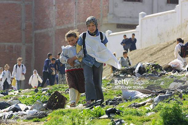 Moroccan teenagers are on the way to school 20 March 2004 in Tangiers' Bani Makada quarter a popular Islamic fundamentalist stronghod Tangiers with...