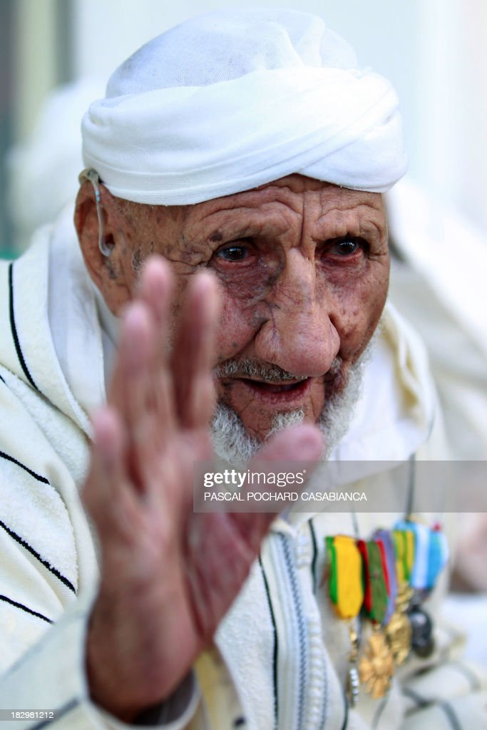 A Moroccan war veteran, who served as 'Moroccan Goumiers' in the French Army of Africa during WWII, gestures on October 3, 2013 in Bastia during an award ceremony marking the 70th anniversary of the liberation of the French island of Corsica in the Mediterranean Sea.