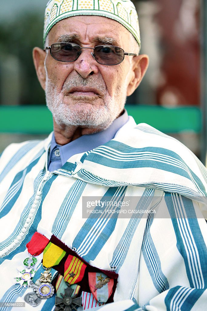 A Moroccan war veteran, who served as 'Moroccan Goumiers' in the French Army of Africa during WWII, poses on October 3, 2013 in Bastia during an award ceremony marking the 70th anniversary of the liberation of the French island of Corsica in the Mediterranean Sea.