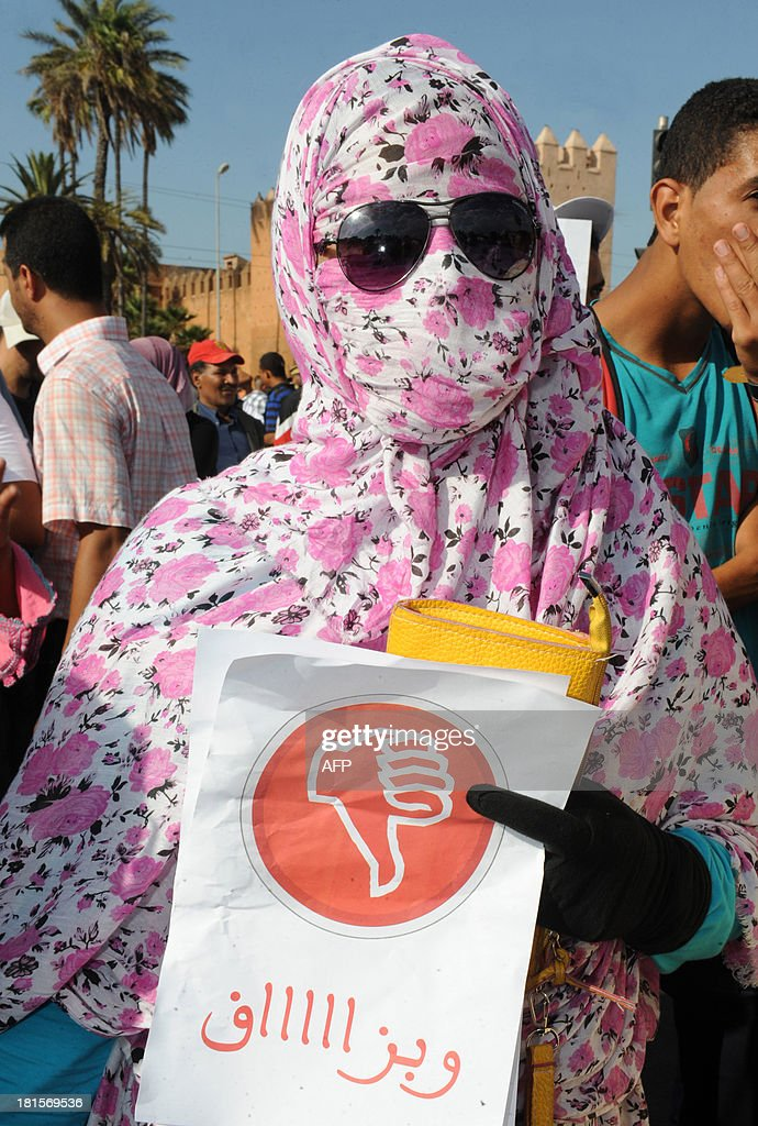 A Moroccan woman attends a demonstration against the Islamist government and the high cost of living after price rises of staple goods on September 22, 2013 in the Moroccan capital, Rabat. Up to 5,000 people took part in the protest after a call by the UGTM trade union which is close to the nationalist Istiqlal party.