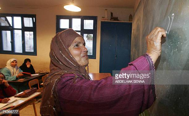 Moroccan woman attends literacy lessons to learn how to read and write in Temara near Rabat 30 May 2007 Some 528 percent of Moroccan voters are...