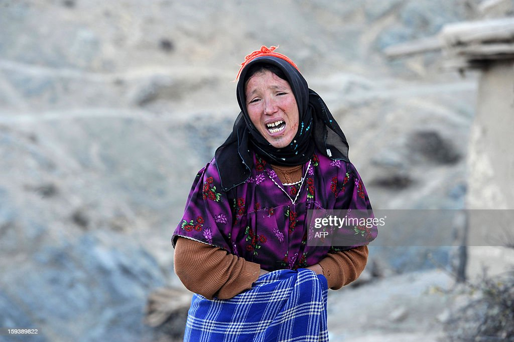 A Moroccan woman mourns during the funeral of a villager who died after falling ill and being untreated due to lack of vital medical care in Anfgou in the High Atlas mountains on January 12, 2013. More than 20 tons of food and hundreds of duvets and mattresses were distributed to villagers who are facing an unusually bitter winter, causing hardship not usually associated with Morocco.