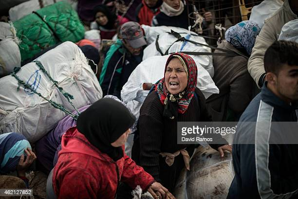 Moroccan woman screams as she waits to cross the 'Barrio Chino' border crossing point between Melilla and Morocco on January 20 2015 in Melilla Spain...