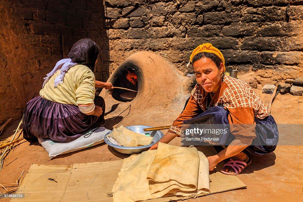 Moroccan women baking bread - khubz