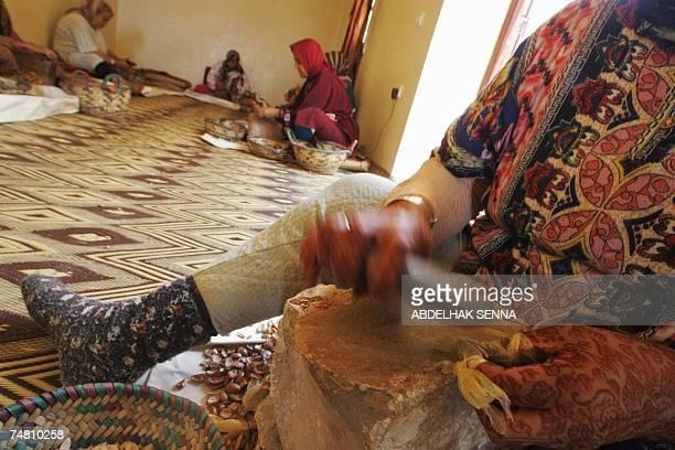 Moroccan women crush Argan tree nuts 18 June 2007 in Smimmou near Essaouira to make Argan oil The Argan tree is unknown for many people since it...