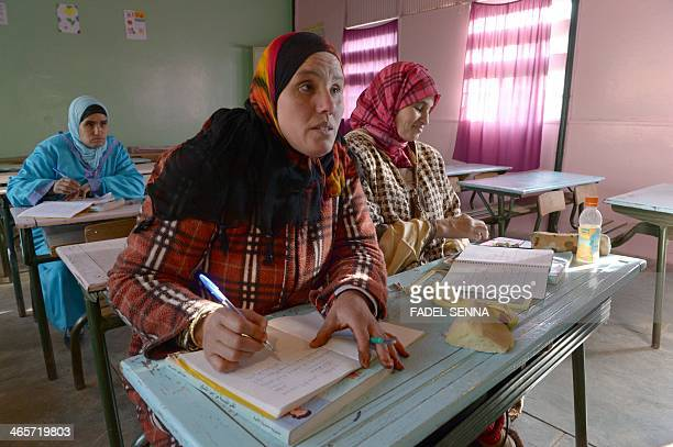 Moroccan women learn how to read write and calculate during a lesson in the village of Timoulilt in Azilal Province of the TadlaAzilal region of...