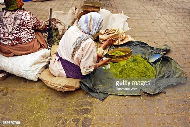 Moroccan women selling henne