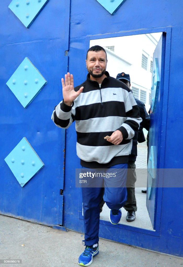 Moroccan Younes Chekkouri, a former Guantanamo detainee who was transferred in September 2015 back to a prison in his country after fourteen years of detention, gestures as he leaves the prison in the city of Sale, north of the capital Rabat, on February 11, 2016. Chekkouri's lawyer confirmed that his release is temporary and that his client will stand trial again on February 23, 2016 in charges related to belonging to an Islamic jihadist group. / AFP / STR
