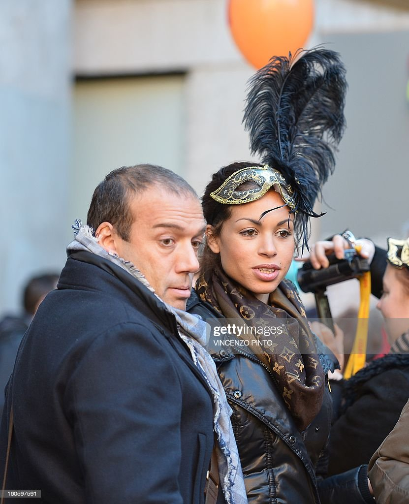 Moroccan-born exotic dancer Karima El-Mahroug, known as Ruby, at the centre of former Italian prime minister Silvio Berlusconi's trial for underage sex, walks at Mark's square with partner Luca Risso during the carnival on February 3, 2013 in Venice. The verdict in former Italian prime minister Silvio Berlusconi's trial for underage sex will not come before the February general elections.