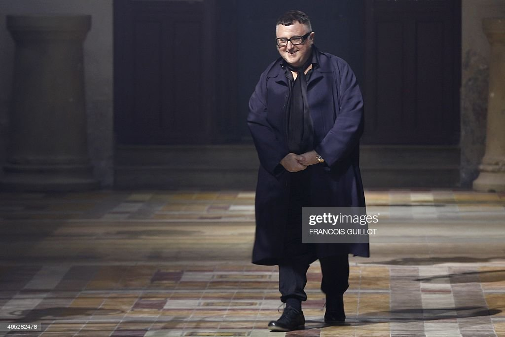 Moroccan-born Israeli designer <a gi-track='captionPersonalityLinkClicked' href=/galleries/search?phrase=Alber+Elbaz&family=editorial&specificpeople=783481 ng-click='$event.stopPropagation()'>Alber Elbaz</a> for Lanvin acknowledges the public during the 2015-2016 fall/winter ready-to-wear collection fashion show on March 5, 2015 in Paris. AFP PHOTO / FRANCOIS GUILLOT