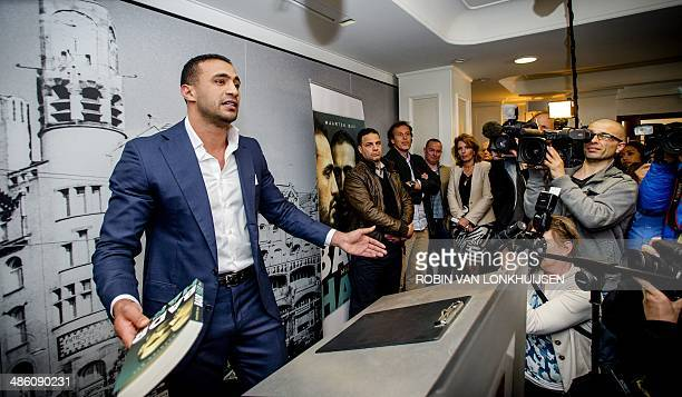 Moroccanborn kickboxer Badr Hari speaks to reporters during the presentation of the book 'Badr Hari Mijn Verhaal in Amsterdam on April 22 2014...