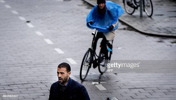 MoroccanDutch Former K1 heavyweight kickboxing champion Badr Hari arrives at the courthouse in Amsterdam the Netherlands on January 23 2014 Hari...