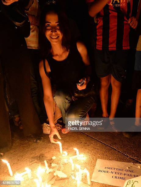 Moroccans light candles during a demonstration against the arrest of two Moroccan women after their outfits were deemed inappropriate in Casablanca...