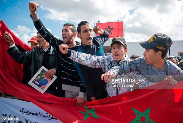 Moroccans shout slogans during a demonstration outside the court in Sale on March 13 2017 against the killing of security forces in the Western...