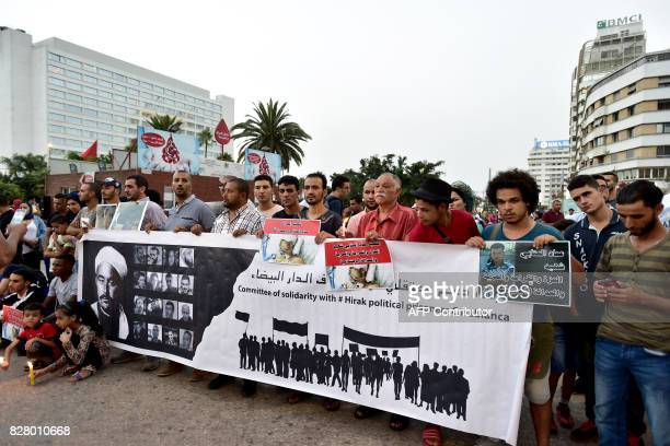 Moroccans take part in a candle light vigil in Casablanca on August 8 2017 for a protestor who died in the Rif protests in northern Morocco after he...