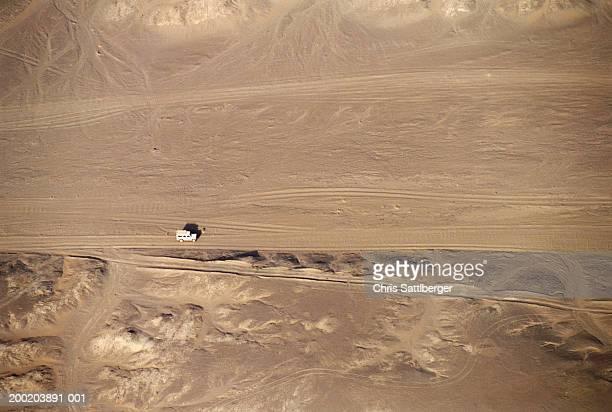Morocco, Erg Chebbi, 4X4 vehicle driving across desert, aerial view