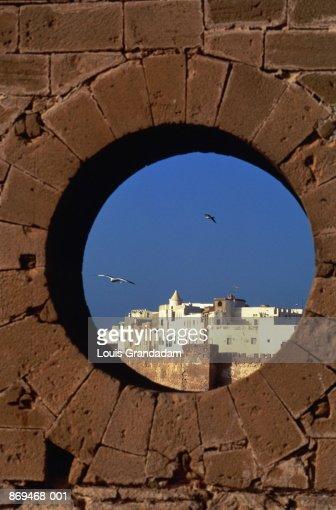 Morocco, Essaouira Harbour seen through fortress portal
