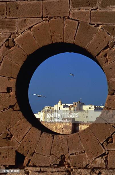 Morocco, Essaouira Harbour seen through fortress portal