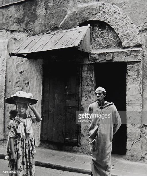 Morocco Essaouira street scene with man and girl