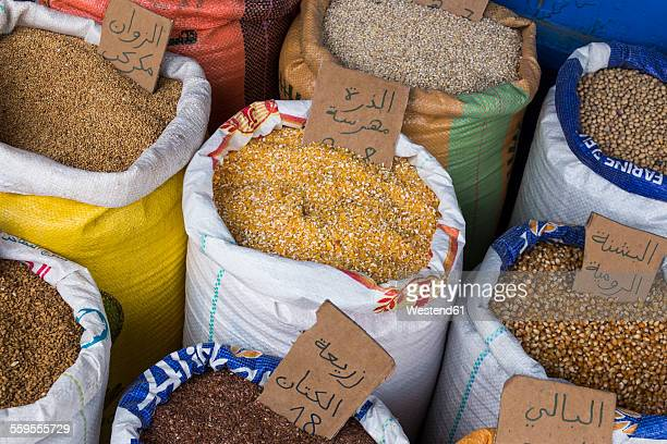 Morocco, Essaouria, sacks of different grains on the market