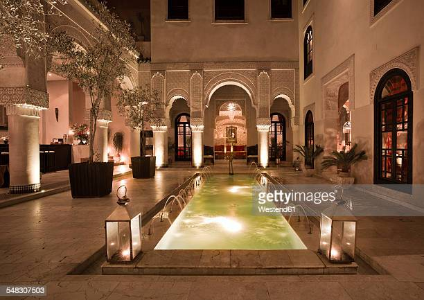 Morocco, Fes, Hotel Riad Fes, courtyard with lightened pool by night