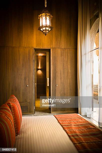 Morocco, Fes, Hotel Riad Fes, hotel room with bed and wood panelling
