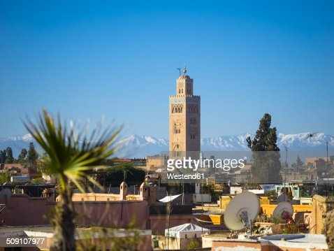 Morocco, Marrakech, Koutoubia Mosque with Atlas mountains in background