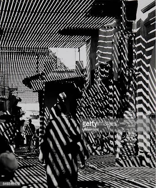 Morocco Marrakech shadows street in the Souk market