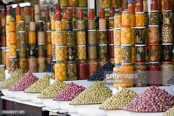 Morocco, Marrakesh, jars and bowls of olives on market stall
