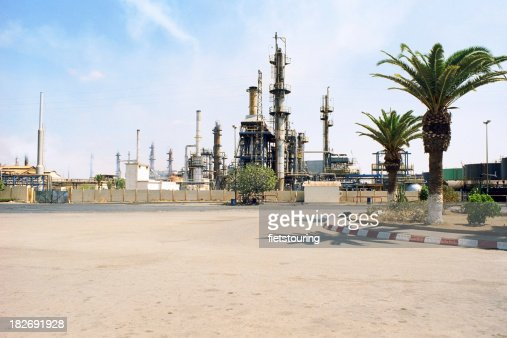 Morocco oil refinery in the desert palm trees