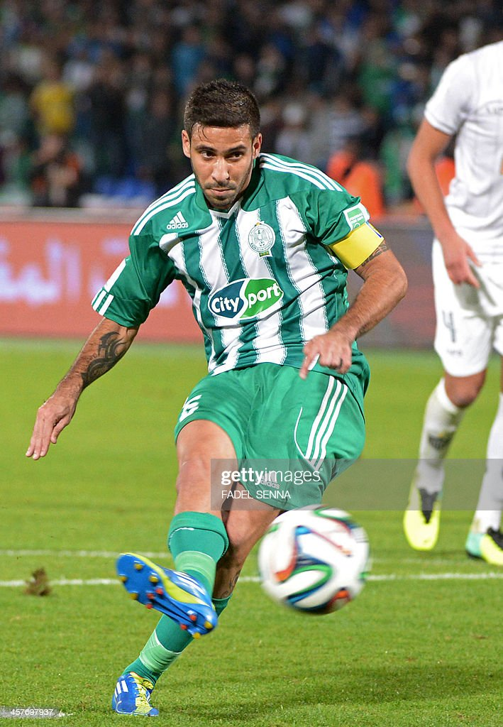 Morocco Raja Casablanca's Mouhcine Moutouali (L) kicks the ball during his semi-final football match against Brazil's Atletico Mineiro, as part of the 2013 FIFA Club World Cup, in the Moroccan city of Marrakesh, on December 18, 2013. The regional champions from each of the FIFA regions are gathering in the north African country of Morocco to decide which is the best domestic team in the world.