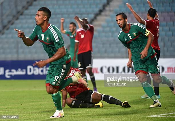 Morocco striker Nabil Dirar jubilates with his teammate Mehdi Benatia during the qualifying tournament for the Africa Nations Championship Gabon 2017...