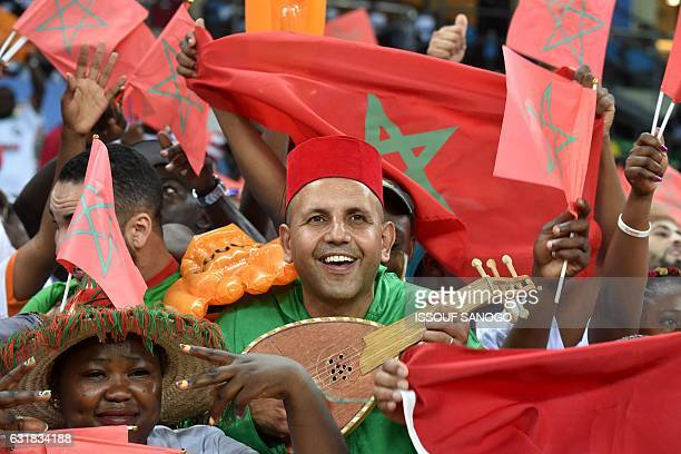 A Morocco supporter cheers for his team during the 2017 Africa Cup of Nations group C football match between DR Congo and Morocco in Oyem on January...