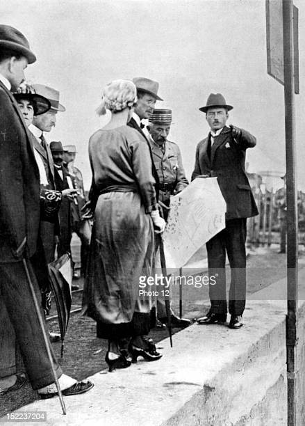 Morocco The Belgian sovereigns visiting Morocco Marshal Lyautey showing King Albert and Queen Elisabeth a map of the port of Casablanca while an...