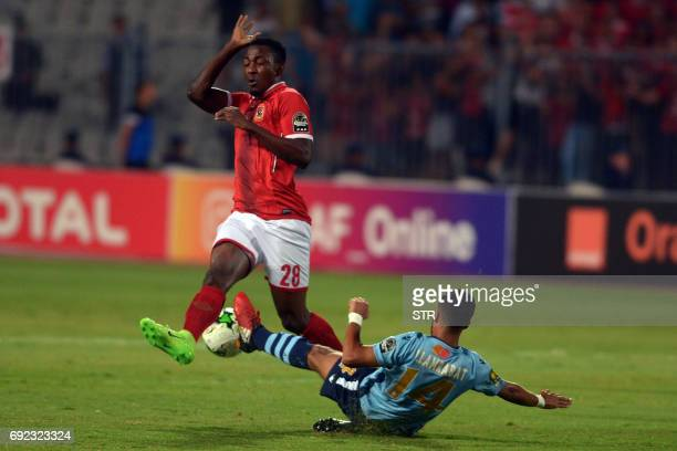 Morocco Wydad Casablanca's player Lamrabat vies for the ball with Egypt's Al Ahly player Ajayi during the African Champions League group stage...